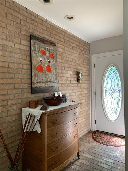 Real Estate Photography - 906 N Bancroft Pkwy, Wilmington, DE, 19805 - Welcoming Foyer w Brick Wall & Floor
