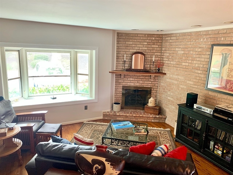 Real Estate Photography - 906 N Bancroft Pkwy, Wilmington, DE, 19805 - Step-Down Living Room w Bay Window & Fireplace