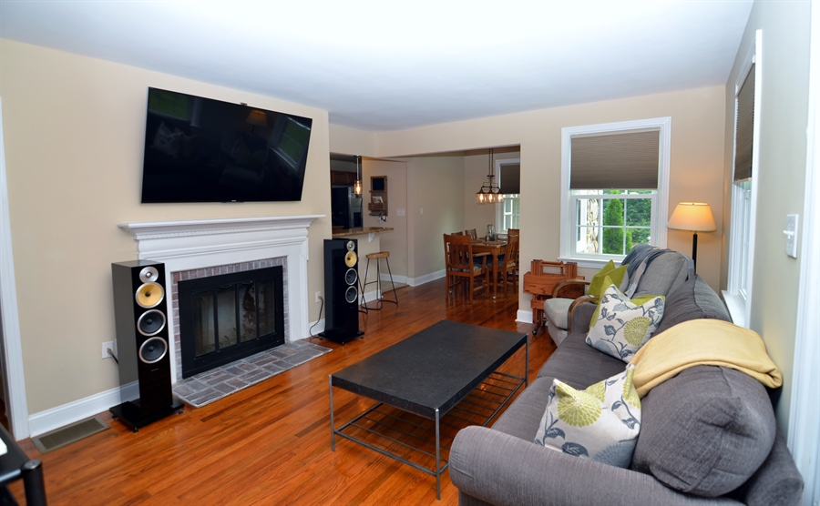Real Estate Photography - 312 S Dupont Rd, Wilmington, DE, 19805 - Living Room with Hardwood Floors and Fireplace