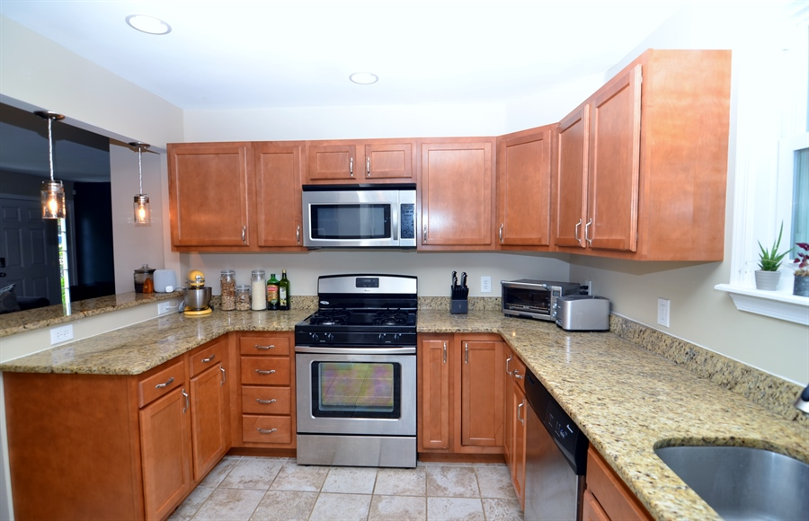 Real Estate Photography - 312 S Dupont Rd, Wilmington, DE, 19805 - Kitchen with Granite Counters