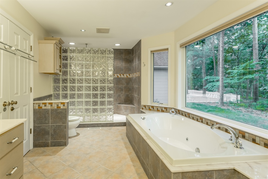 Real Estate Photography - 2 Blue Heron Dr, Georgetown, DE, 19947 - Master bath, huge soaking tub with great view