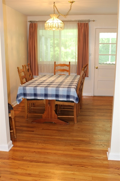Real Estate Photography - 1212 Winstead Rd, Wilmington, DE, 19803 - Dining Room leading out to the screened in porch