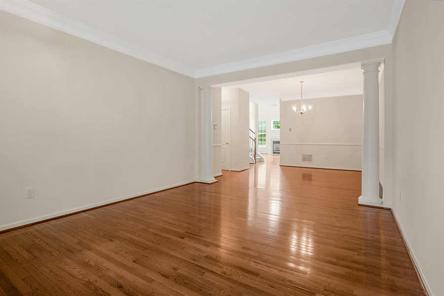 Real Estate Photography - 140 Farm Meadows Ln, Hockessin, DE, 19707 - Lving Room opens to Dining Room