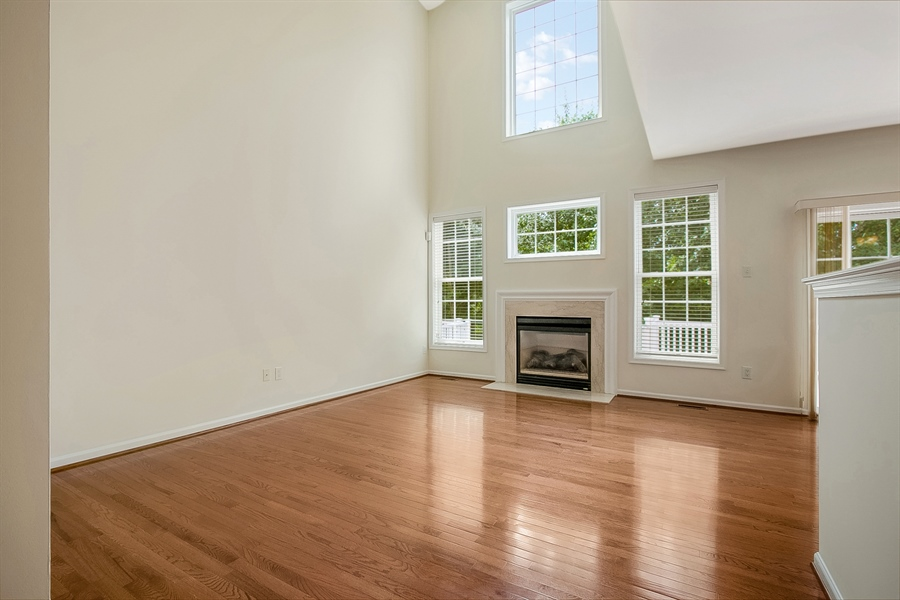 Real Estate Photography - 140 Farm Meadows Ln, Hockessin, DE, 19707 - Family Room with Vaulted Ceiling