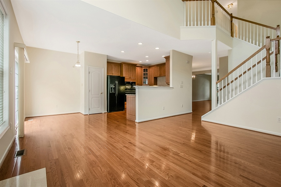 Real Estate Photography - 140 Farm Meadows Ln, Hockessin, DE, 19707 - Family Room opens to Kitchen