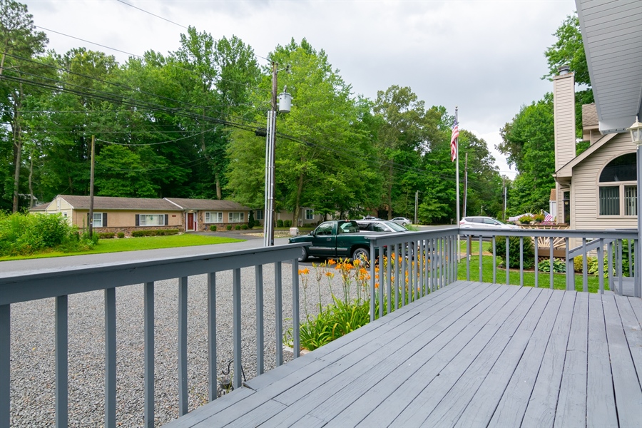 Real Estate Photography - 32775 Bridgeway Dr E, Lewes, DE, 19958 - Spacious front Deck