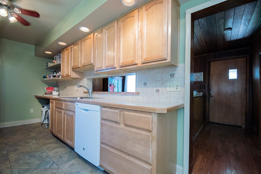 Real Estate Photography - 3112 W Court Ave, Claymont, DE, 19703 - Kitchen with solid wood cabinets