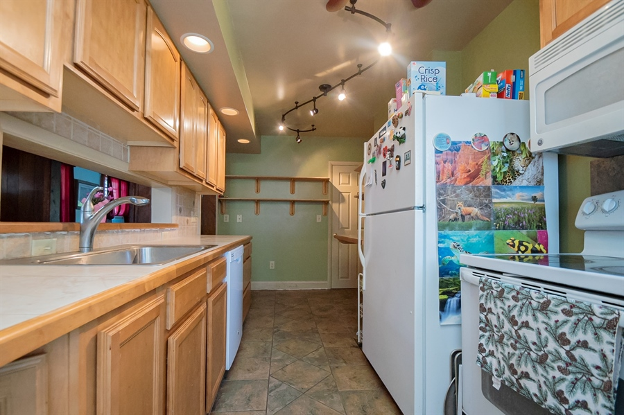 Real Estate Photography - 3112 W Court Ave, Claymont, DE, 19703 - Kitchen with large stainless sink