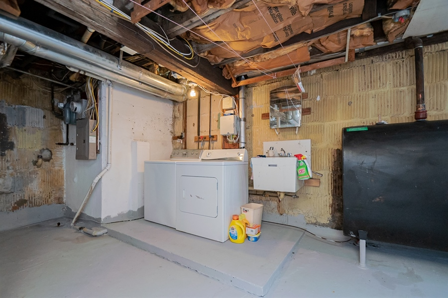 Real Estate Photography - 3112 W Court Ave, Claymont, DE, 19703 - Laundry in basement