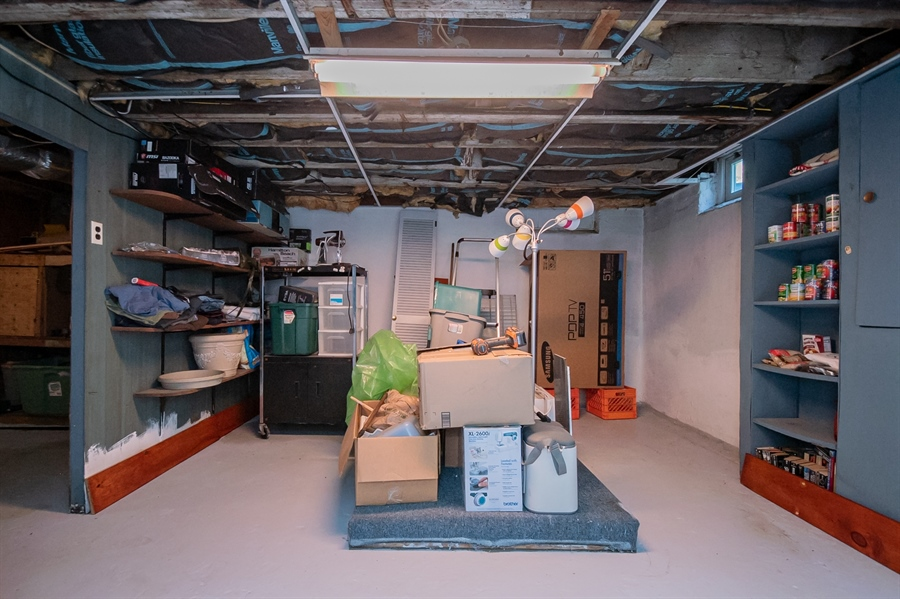Real Estate Photography - 3112 W Court Ave, Claymont, DE, 19703 - Basement w/ ample storage