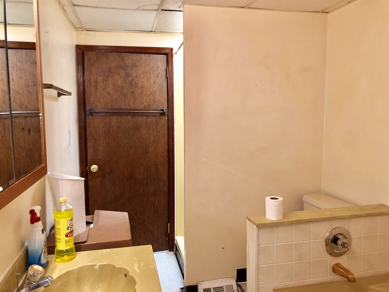 Real Estate Photography - 31 3rd Ave, Claymont, DE, 19703 - Full Bath with Tub and Stall Shower