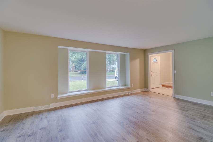 Real Estate Photography - 25 Freedom Dr, Dover, DE, 19904 - Inviting Living Room with New Windows