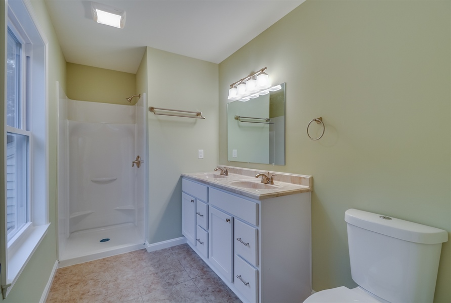 Real Estate Photography - 25 Freedom Dr, Dover, DE, 19904 - Master Bathroom