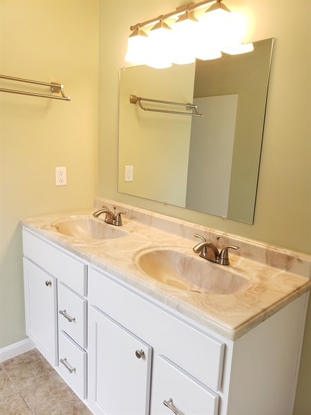 Real Estate Photography - 25 Freedom Dr, Dover, DE, 19904 - Double Vanity in Master Bathroom