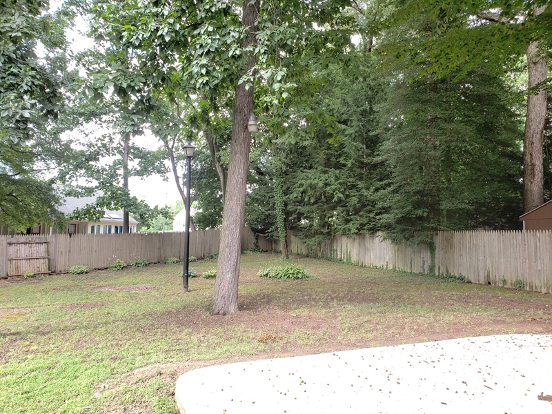 Real Estate Photography - 25 Freedom Dr, Dover, DE, 19904 - Fenced Back Yard
