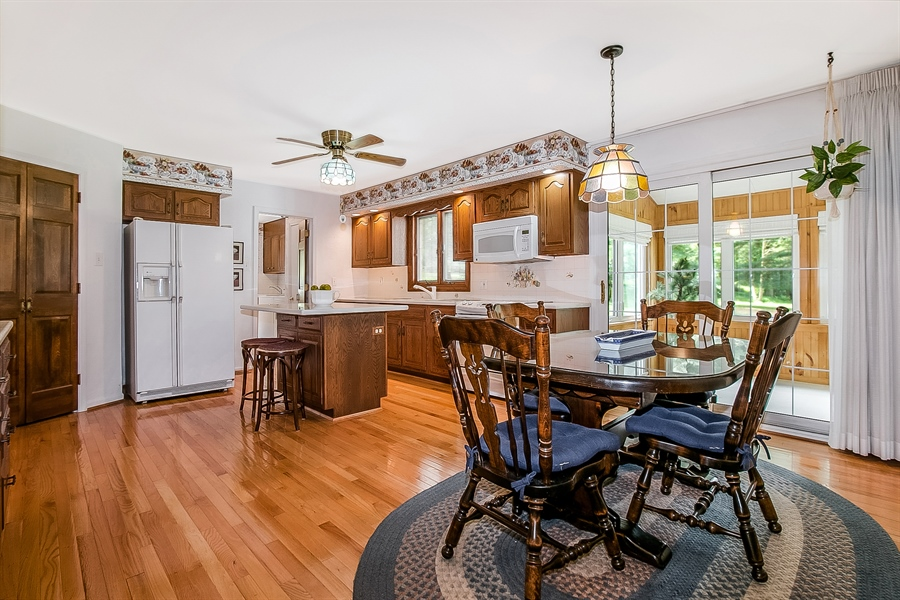 Real Estate Photography - 109 Bridleshire Ct, Newark, DE, 19711 - Large Eat In Kitchen opens to Sunroom