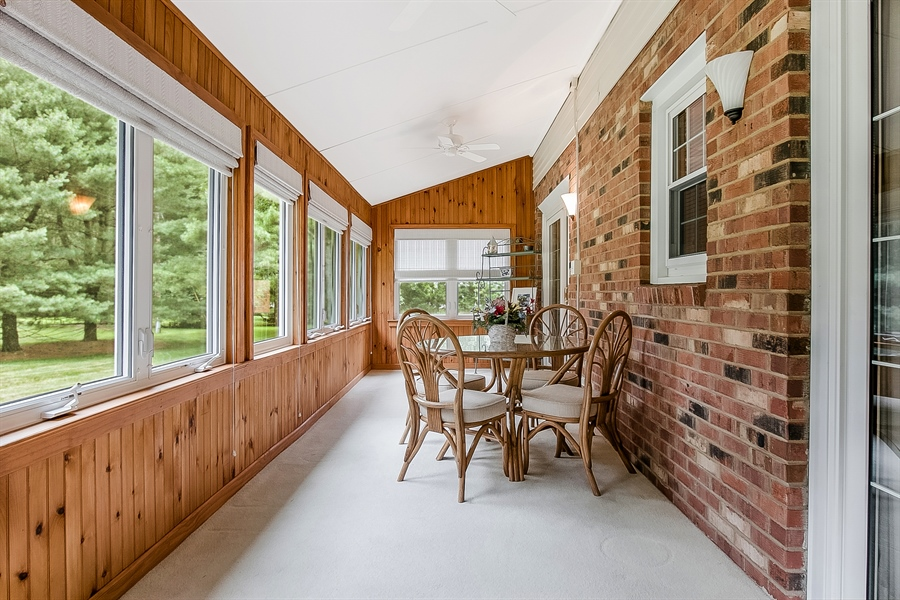 Real Estate Photography - 109 Bridleshire Ct, Newark, DE, 19711 - Sunroom Opens to Kitchen and Fam Rm