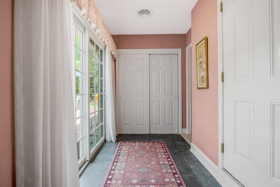 Real Estate Photography - 3112 Centerville Rd, Greenville, DE, 19807 - Hallway - Access to Garage, Patio, & In-Law Suite