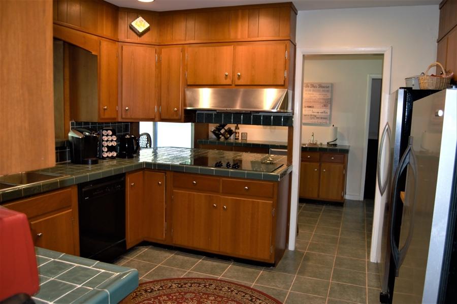Real Estate Photography - 3112 Centerville Rd, Greenville, DE, 19807 - Kitchen - View 1 Toward Bar Area