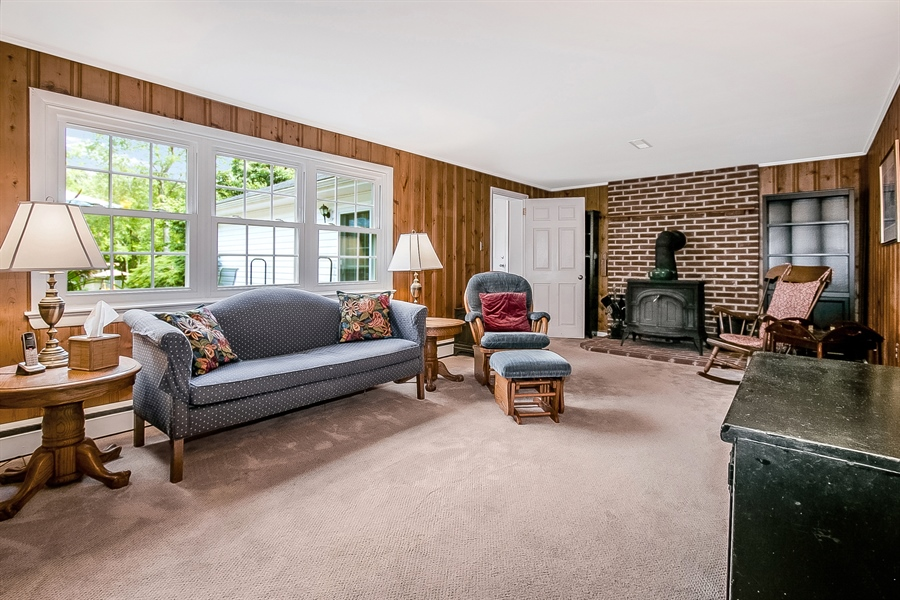 Real Estate Photography - 3112 Centerville Rd, Greenville, DE, 19807 - Lower Level Family Room - View 1