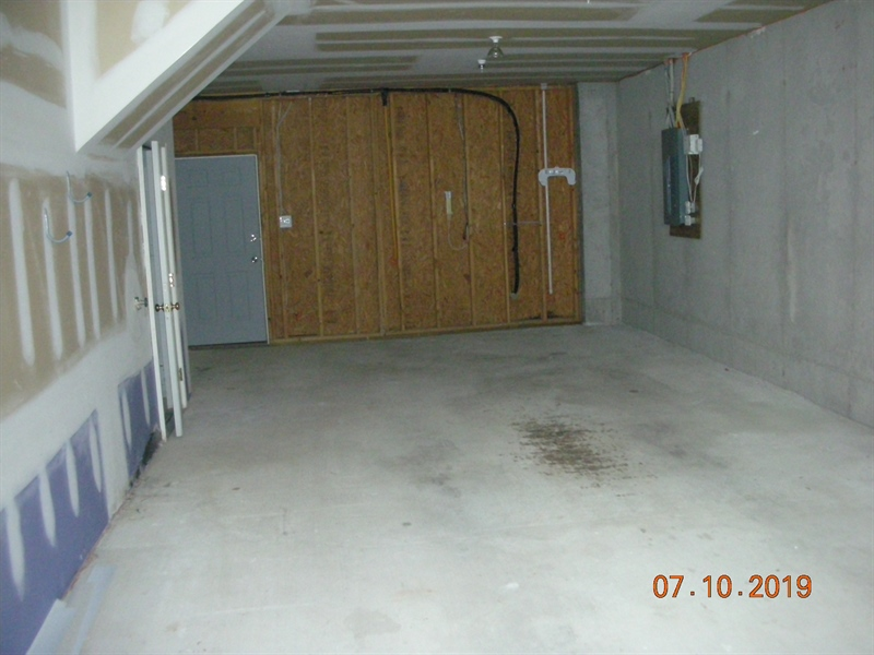 Real Estate Photography - 26736 Chatham Lane #B217, B217, Millsboro, DE, 19966 - Garage