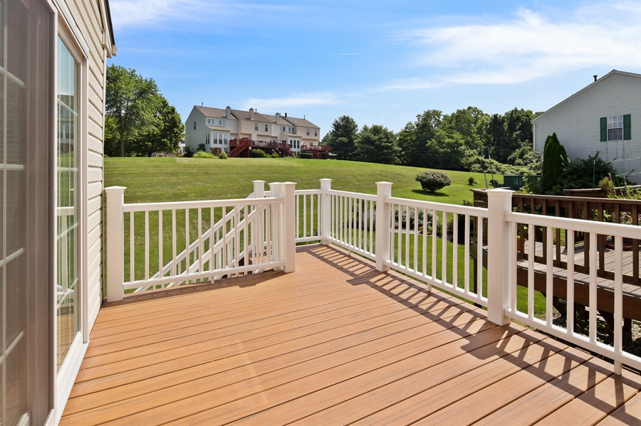 Real Estate Photography - 253 Sloan Ct, Wilmington, DE, 19808 - 9'x11' Timber Tech deck with stairs to back yard