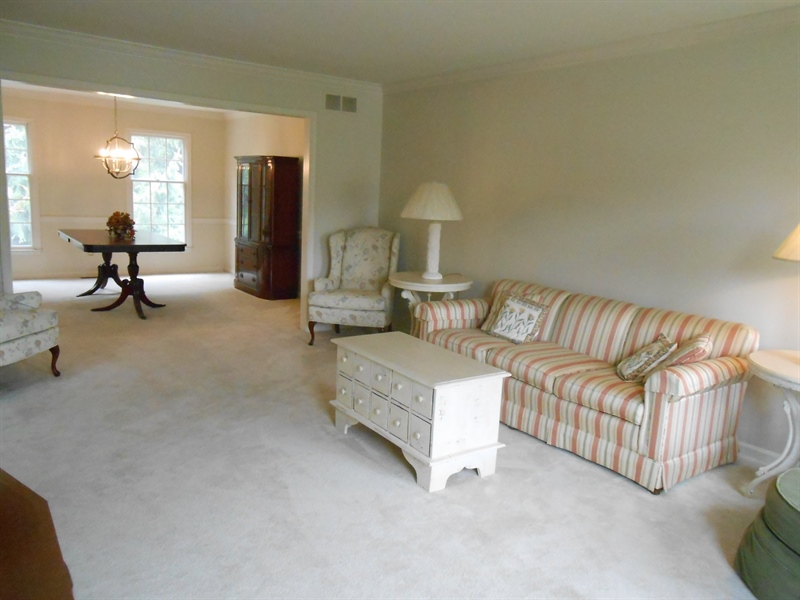 Real Estate Photography - 3 Homestead Ln, Hockessin, DE, 19707 - Living Room Opens to Dining Room