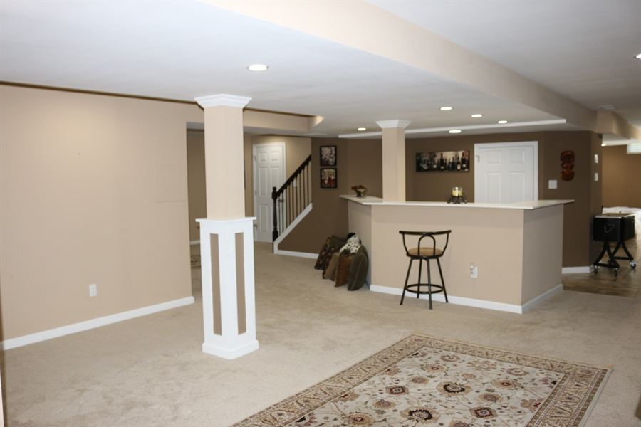 Real Estate Photography - 127 Willow Grove Mill Dr, Middletown, DE, 19709 - Finished Basement Flooded w/ Recess Lights