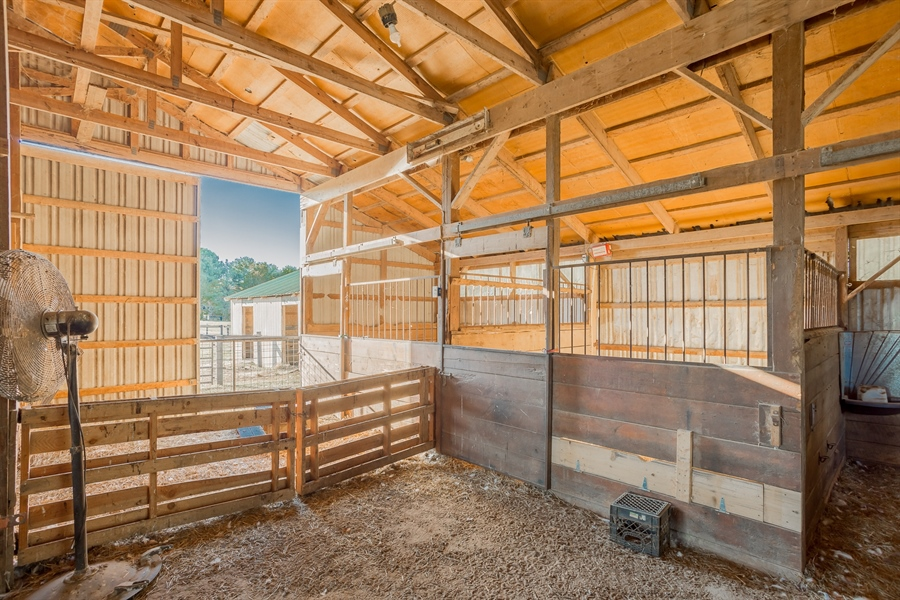 Real Estate Photography - 281 Marjorie Ln, Harrington, DE, 19952 - INTERIOR OF BARN WITH LARGE BOX STALLS