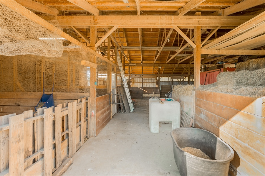 Real Estate Photography - 281 Marjorie Ln, Harrington, DE, 19952 - INTERIOR OF THE BARN FEATURING LARGE BOX STALLS