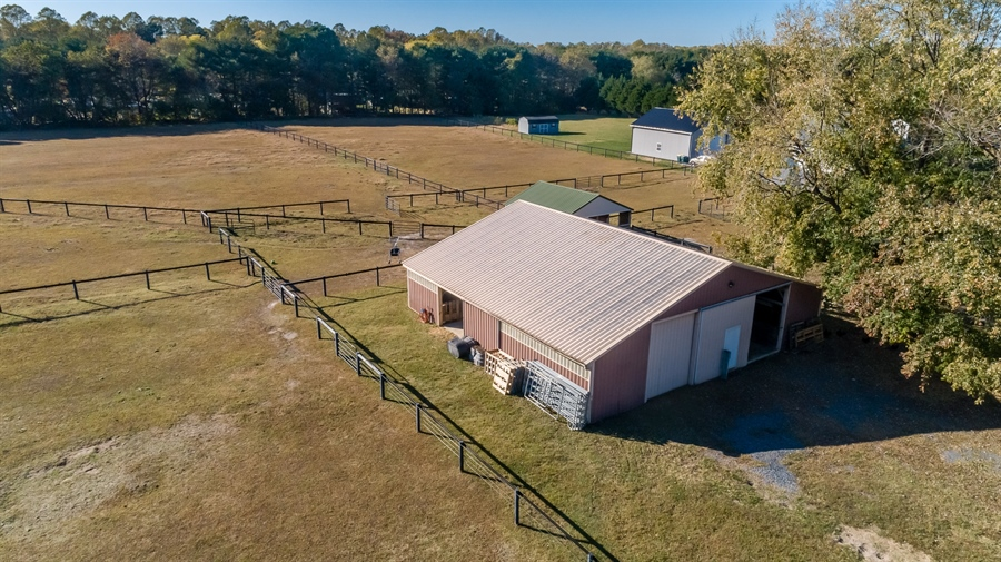 Real Estate Photography - 281 Marjorie Ln, Harrington, DE, 19952 - AERIAL OF THE BARN AND SOME OF THE PASTURES