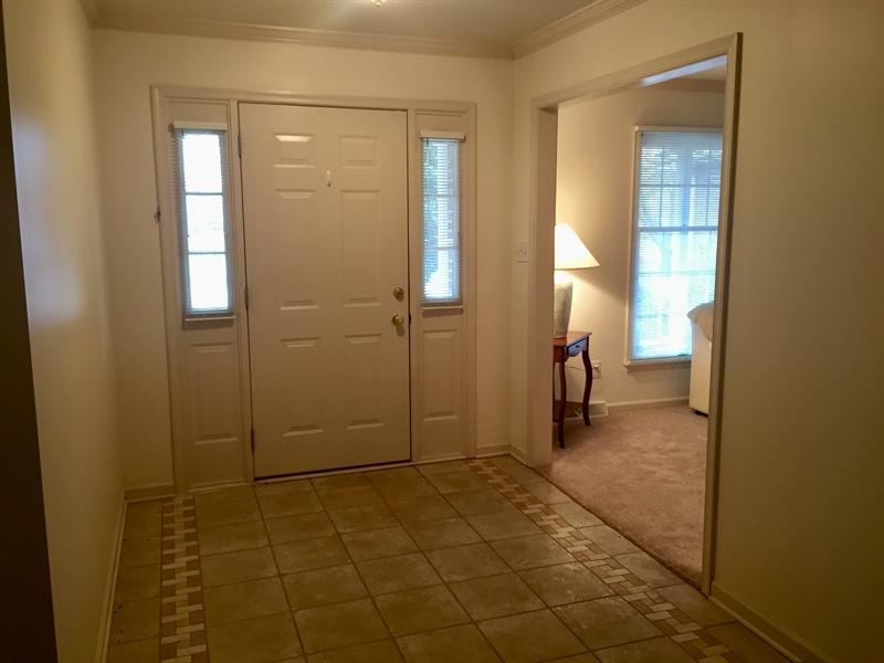 Real Estate Photography - 6 Steffie Dr, Bear, DE, 19701 - Ceramic tile in foyer & new carpeting in hallway