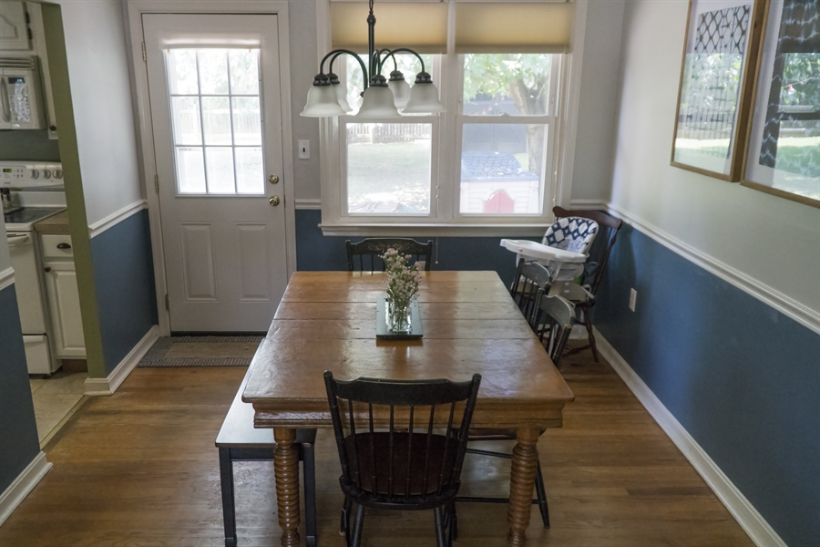 Real Estate Photography - 1209 Mayfield Rd, Wilmington, DE, 19803 - Dining Rm With Wood Floors & Access to Fenced Yard