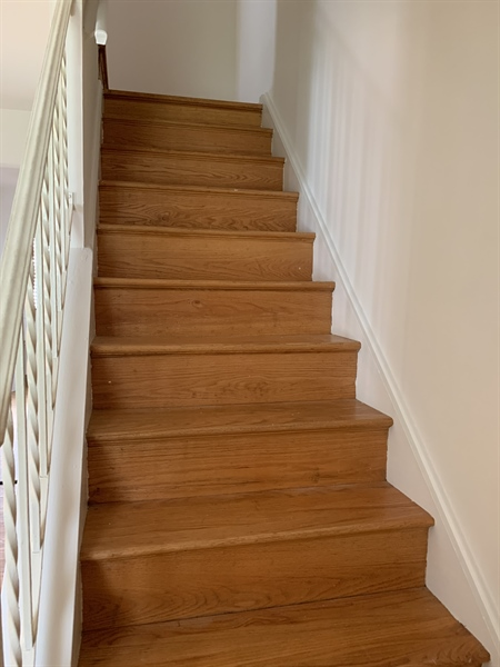 Real Estate Photography - 15 Yeates Dr, New Castle, DE, 19720 - Hardwood flooring staircase