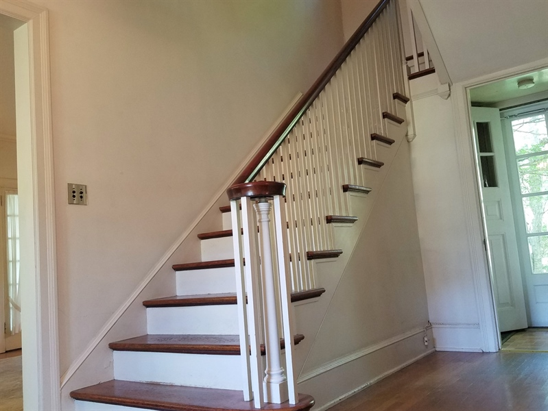 Real Estate Photography - 12 Cragmere Rd, Wilmington, DE, 19809 - Staircase w/ a view of the back door