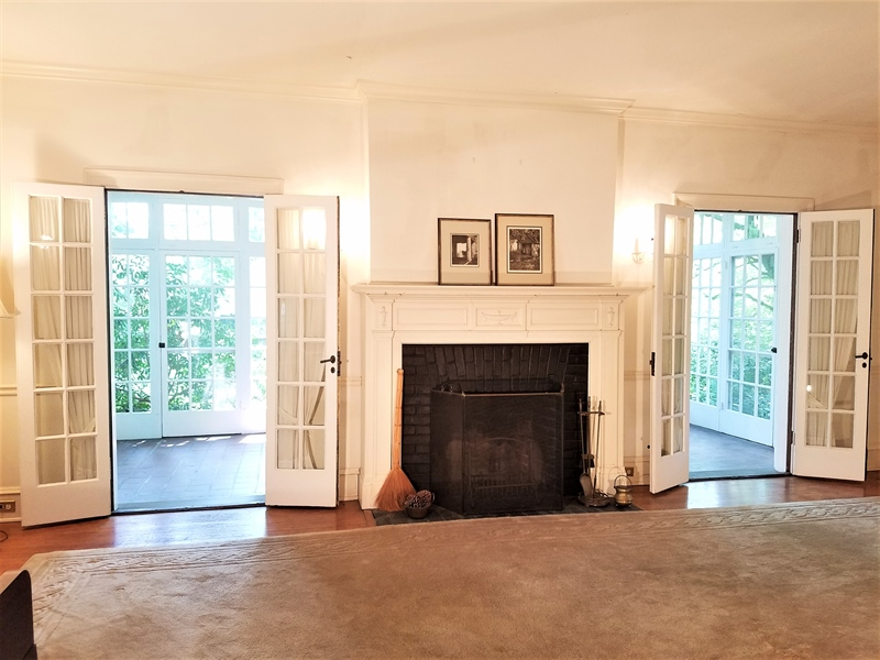 Real Estate Photography - 12 Cragmere Rd, Wilmington, DE, 19809 - Living/Great room w/open double doors to Sun porch