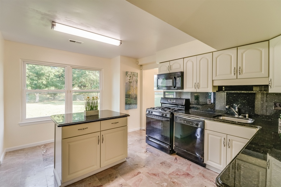 Real Estate Photography - 125 Millcreek Dr, Dover, DE, 19904 - Tile in the kitchen and foyer