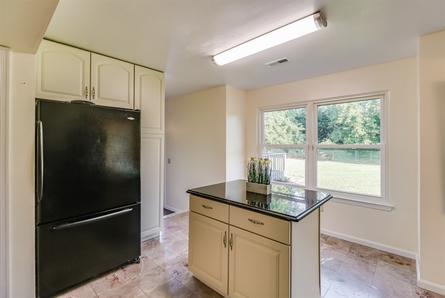 Real Estate Photography - 125 Millcreek Dr, Dover, DE, 19904 - Kitchen island isn't attached to the floor