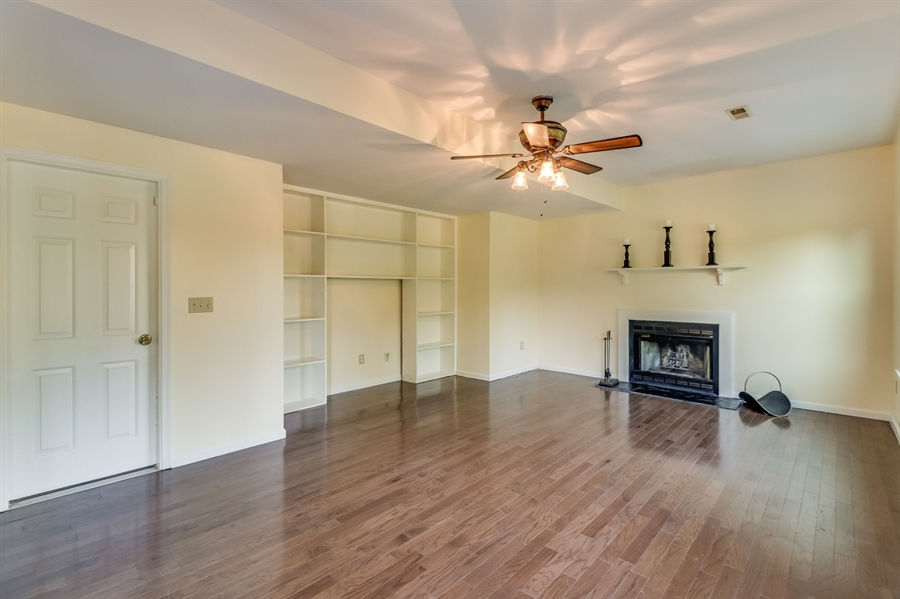 Real Estate Photography - 125 Millcreek Dr, Dover, DE, 19904 - Family room with  built-ins & wood-burning f/place
