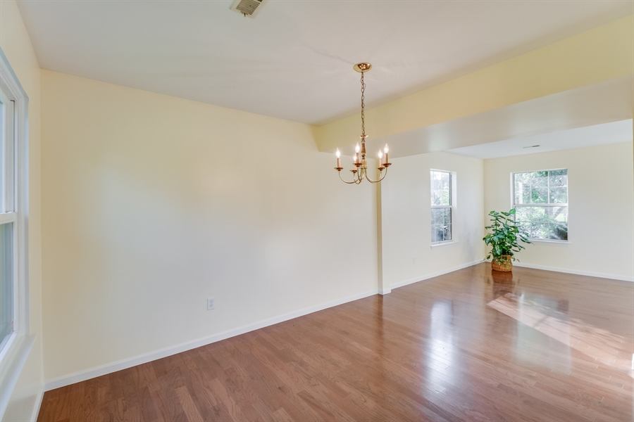 Real Estate Photography - 125 Millcreek Dr, Dover, DE, 19904 - Living room opens to the dining room