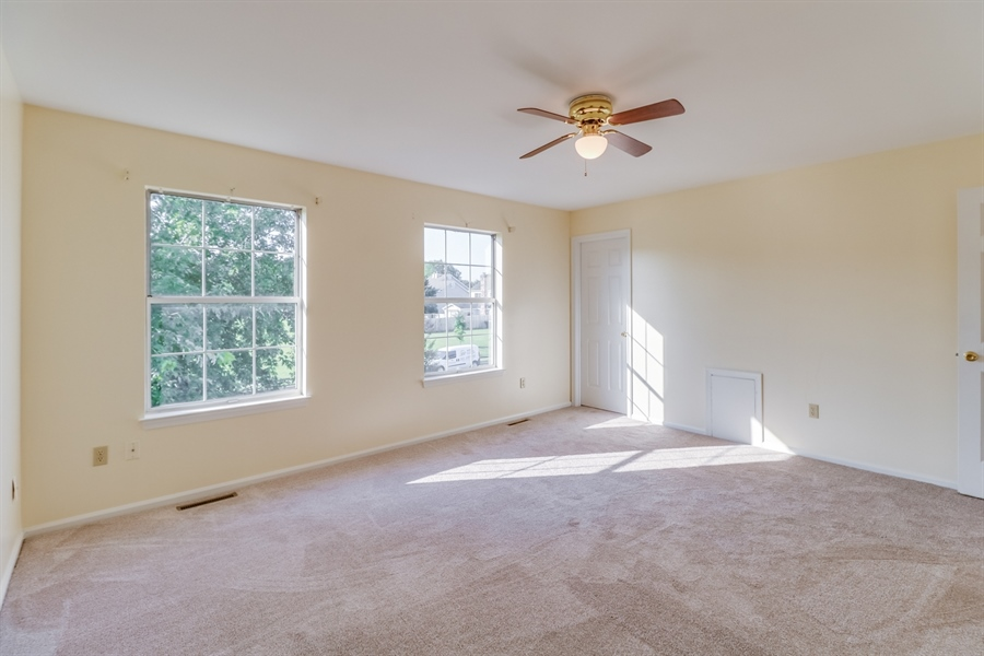Real Estate Photography - 125 Millcreek Dr, Dover, DE, 19904 - Impressive 2nd bedroom with a walk-in closet