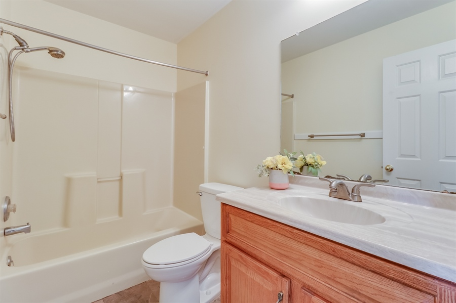 Real Estate Photography - 125 Millcreek Dr, Dover, DE, 19904 - Full bathroom upstairs
