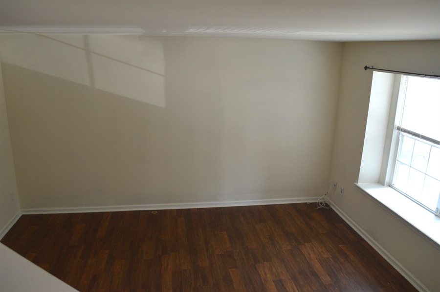 Real Estate Photography - 210 Vincent Cir, Middletown, DE, 19709 - View of Living Room w/ Wood Laminate Floor