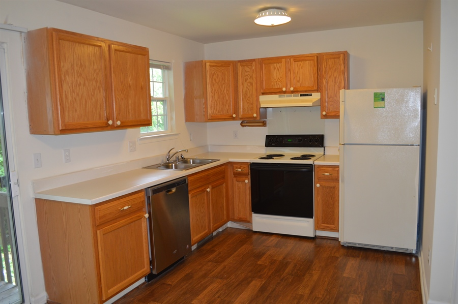 Real Estate Photography - 210 Vincent Cir, Middletown, DE, 19709 - View of Kitchen w/ Wood Laminated Floor