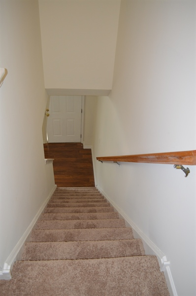 Real Estate Photography - 210 Vincent Cir, Middletown, DE, 19709 - 2nd Floor Stairs Down to Living Room w/ New Carpet