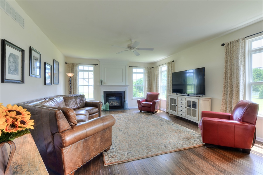 Real Estate Photography - 30096 Stage Coach Cir, Milford, DE, 19963 - Great Room with Gas Fireplace
