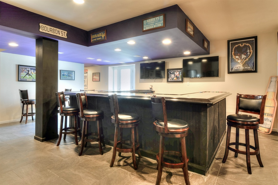 Real Estate Photography - 30096 Stage Coach Cir, Milford, DE, 19963 - Bar in the walkout basement!