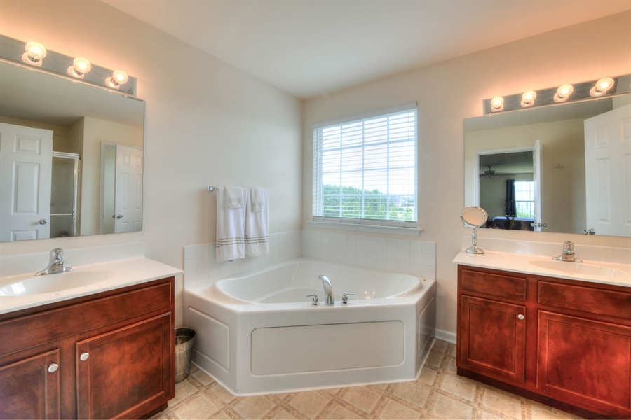 Real Estate Photography - 30096 Stage Coach Cir, Milford, DE, 19963 - Double Vanity, Shower and Soaking Tub in Master