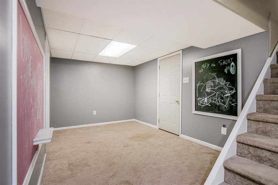 Real Estate Photography - 1715 Pennrock Rd, Wilmington, DE, 19809 - adjacent lower level play area with chalk boards