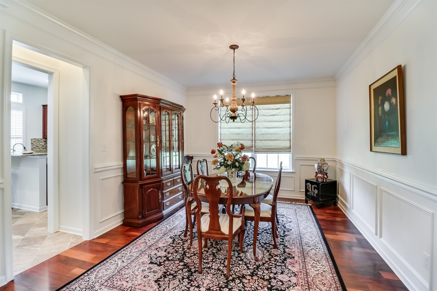 Real Estate Photography - 7771 Clydesdale Ct, Milford, DE, 19963 - Elegant dining room w/hardwood floor
